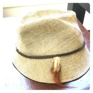 Tan fedora with feather accent
